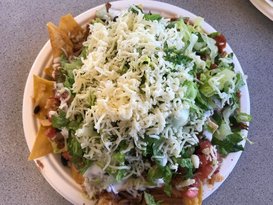 Lamy's Mexican Grill piles toppings on top of a tower of chips, creating a nacho plate heavier than any other.