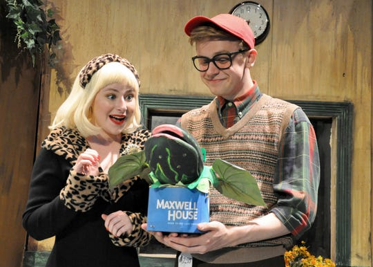 """Audrey (Leah Bakan) admires Seymour's (Nate Jones) newest botanical discovery in the Young Actors Theatre production of """"Little Shop of Horrors"""""""