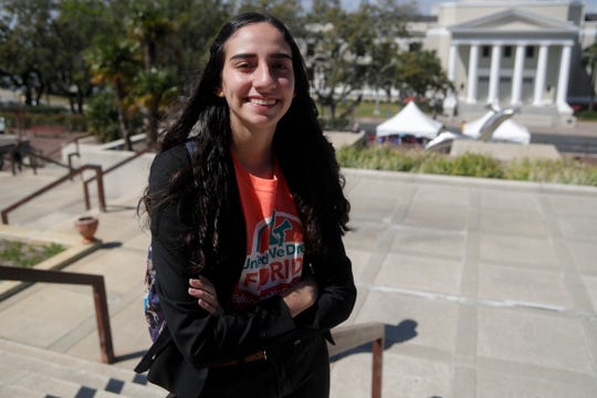 Nataly Chalco Lopez stands in front of the Florida Capitol. She spent the day Tuesday organizing groups to talk to lawmakers about immigration bills.