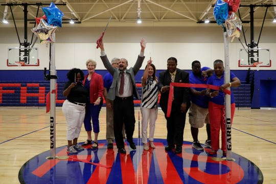 Superintendent Rocky Hanna, center,  cheers after cutting the ribbon at Fairview Middle School signifying the opening of school's new gymnasium Tuesday, March 26, 2019.