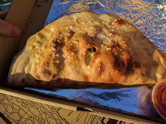This scrumptious calzone is filled with mozzarella, ricotta and a choice of three additional items.  The crust is flipped over, pinched closed, and baked to a golden brown crescent shape at South Beach Pizzeria.