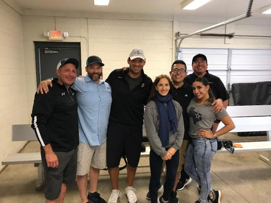 "Tony Romo, center, poses with filmmakers and Burlington, Wis., residents during the filming of ""Now or Never: A Tony Romo Story."""