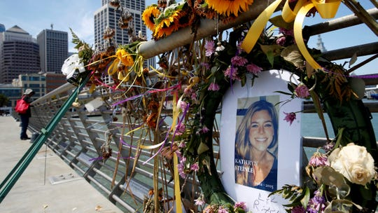 In this July 17, 2015, file photo, flowers and a portrait of Kate Steinle remain at a memorial site on Pier 14 in San Francisco. A federal appeals court refused to reinstate a lawsuit the parents of Kate Steinle filed against San Francisco for refusing to cooperate with federal immigration authorities seeking to deport a man later charged with killing Steinle.