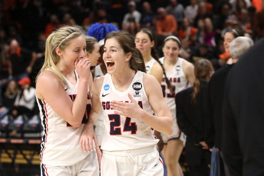 Gonzaga's Katie Campbell (24) and Chandler Smith celebrate their win over Little Rock in a first-round game of the NCAA Women's Tournament last Saturday in Corvallis, Ore. Campbell, who starred at Oaks Christian and Ventura College, had 15 points and seven rebounds.