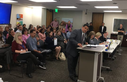 Rick Castaniero, of the Ventura County district of the League of United Latin American Citizens, speaks at a packed meeting of the Ventura County Medi-Cal Managed Care Commission on Monday.