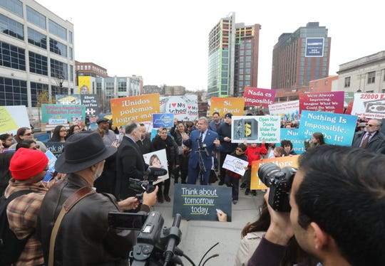 Yonkers Mayor Mike Spano speaks to a crowd of people for New York State to fund Yonkers Schools fairly during a rally in Yonkers March 25, 2019.