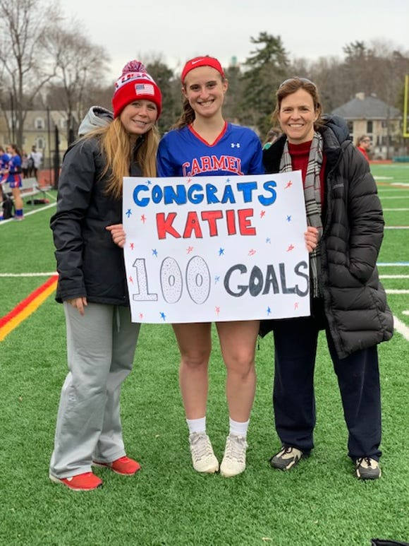Katie Taranto (c) March 25, 2019  after netting her 100th goal on varsity for Carmel High School. The midfielder will play next year for the University of New Hampshire.