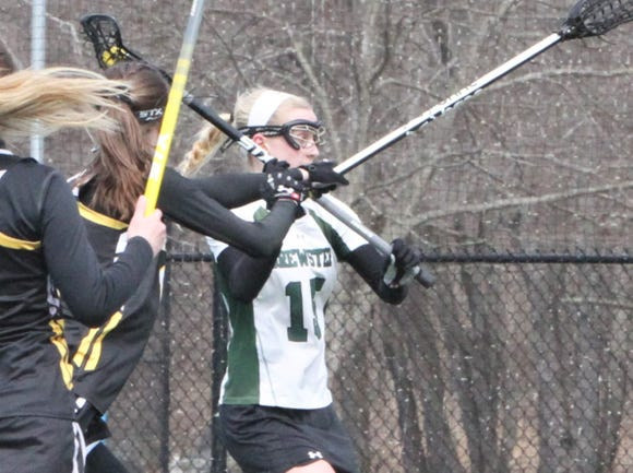 Brewster's Haile Ratajack,  girls lacrosse player of the week, battles against Lakeland/Panas defenders as she drives to the net.