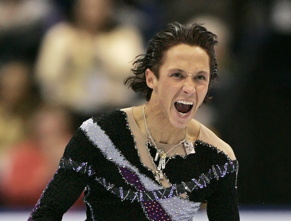 Two-time U.S. figure skating champion Johnny Weir reacts after his performance in the men's free skate event at the U.S. Figure Skating Championships in St. Louis, Saturday, Jan. 14, 2006. Weir finished first in the competition and earned a spot on the U.S. Olympic team going to Turin.
