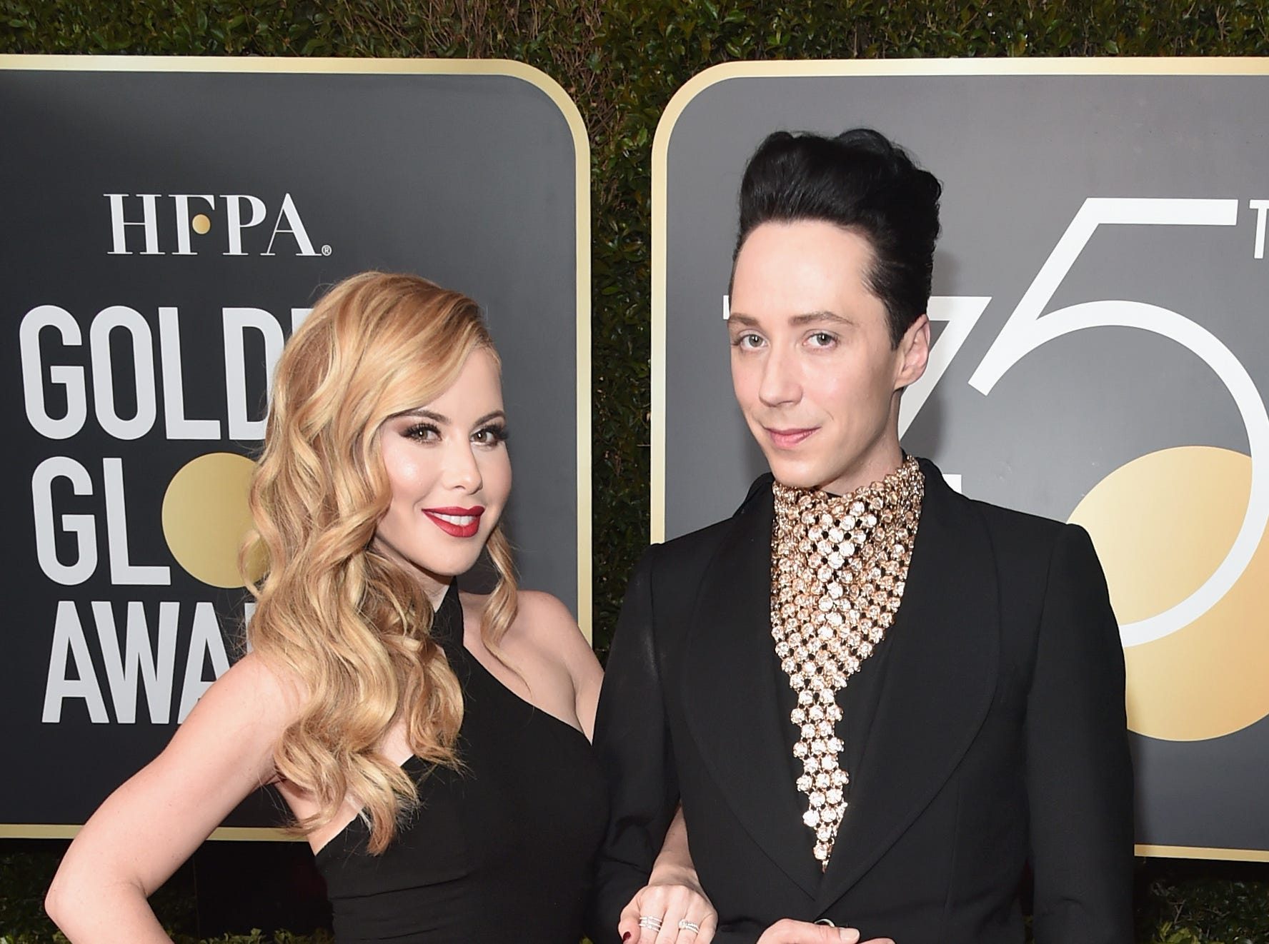 Figure skaters Tara Lipinski and Johnny Weir attend The 75th Annual Golden Globe Awards at The Beverly Hilton Hotel on January 7, 2018 in Beverly Hills, California.