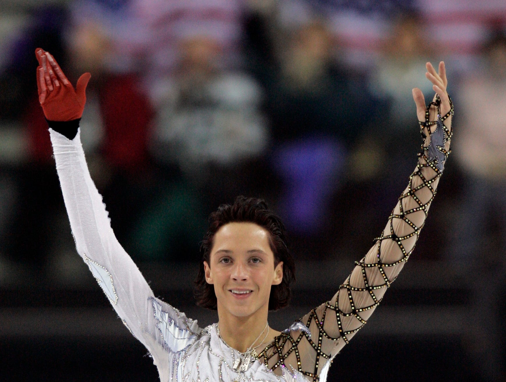 United States' Johnny Weir waves to spectators following his performance at the Men's Figure Skating short program at the Turin 2006 Winter Olympic Games in Turin, Italy, Tuesday, Feb. 14, 2006.