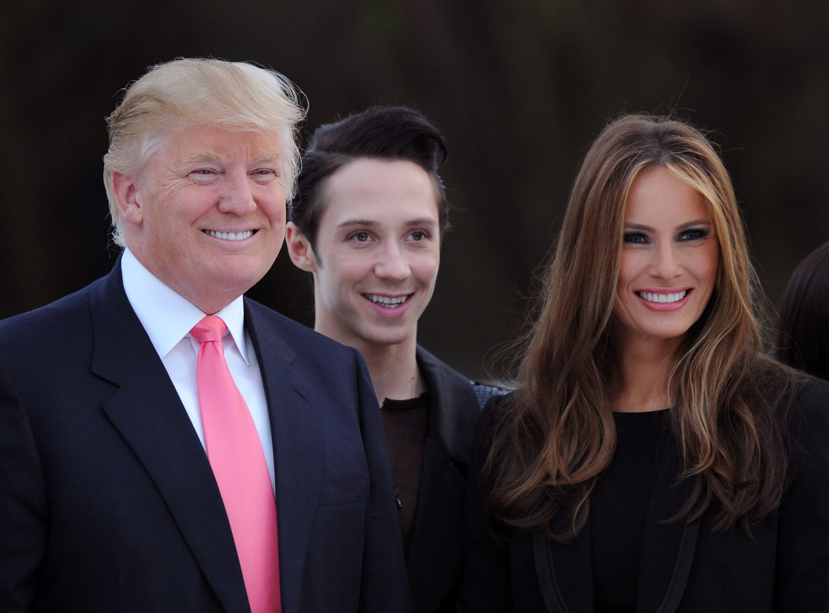 Donald Trump, figure skater Johnny Weir and Melania Trump attend the Figure Skating in Harlem's 2010 Skating with the Stars benefit gala in Central Park on April 5, 2010 in New York City.