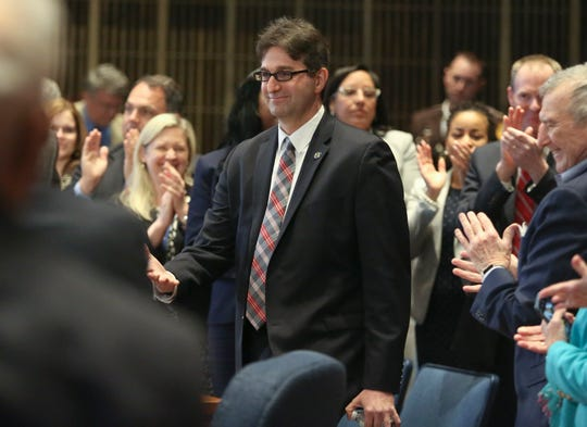 New Castle County Executive Matt Meyer enters the council chambers to deliver his budget address to the county council Tuesday at the Louis L. Redding City/County Building in Wilmington.