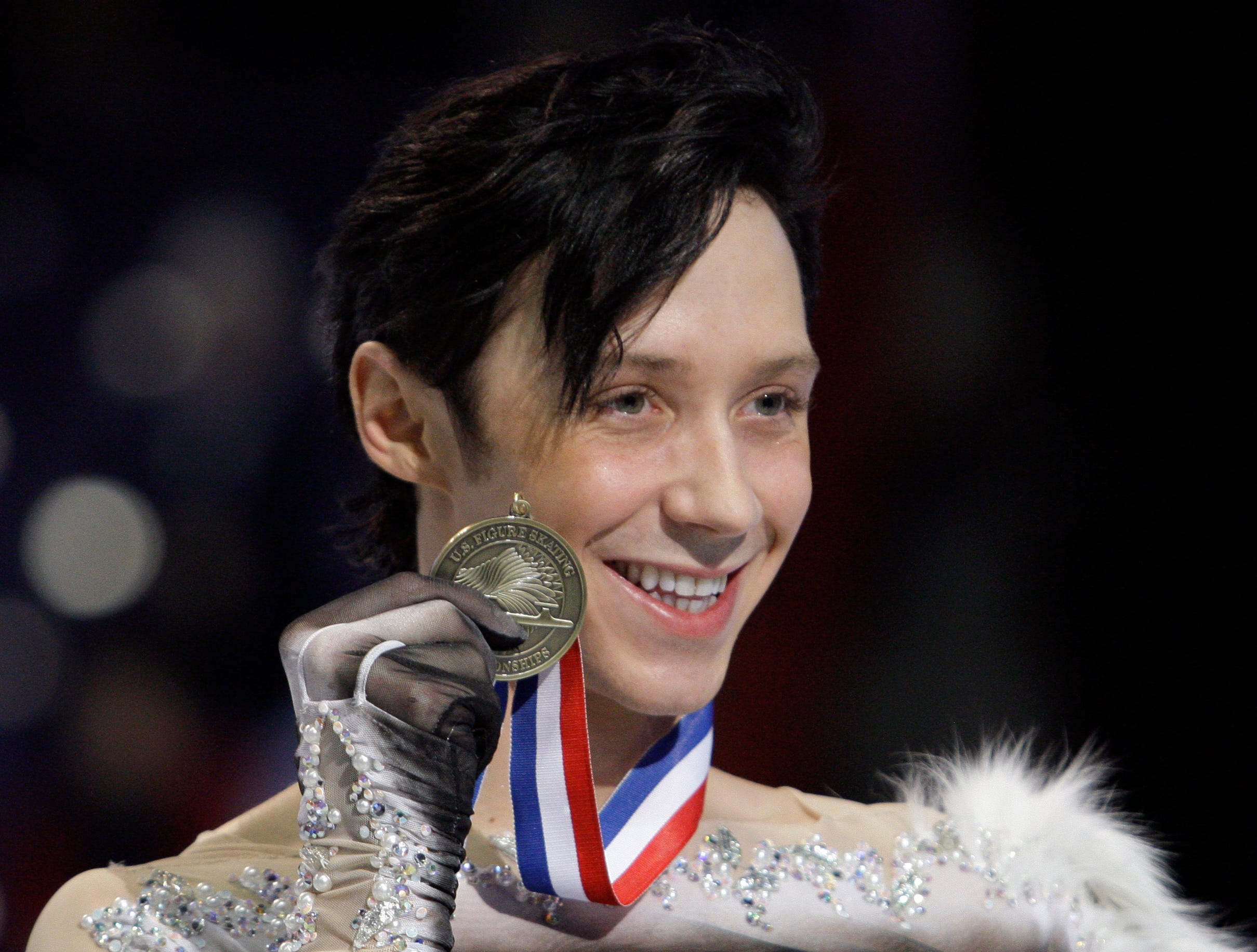 Johnny Weir shows off his medal for third place during the men's free skate at the U.S. Figure Skating Championships in Spokane, Wash., Sunday, Jan. 17, 2010.