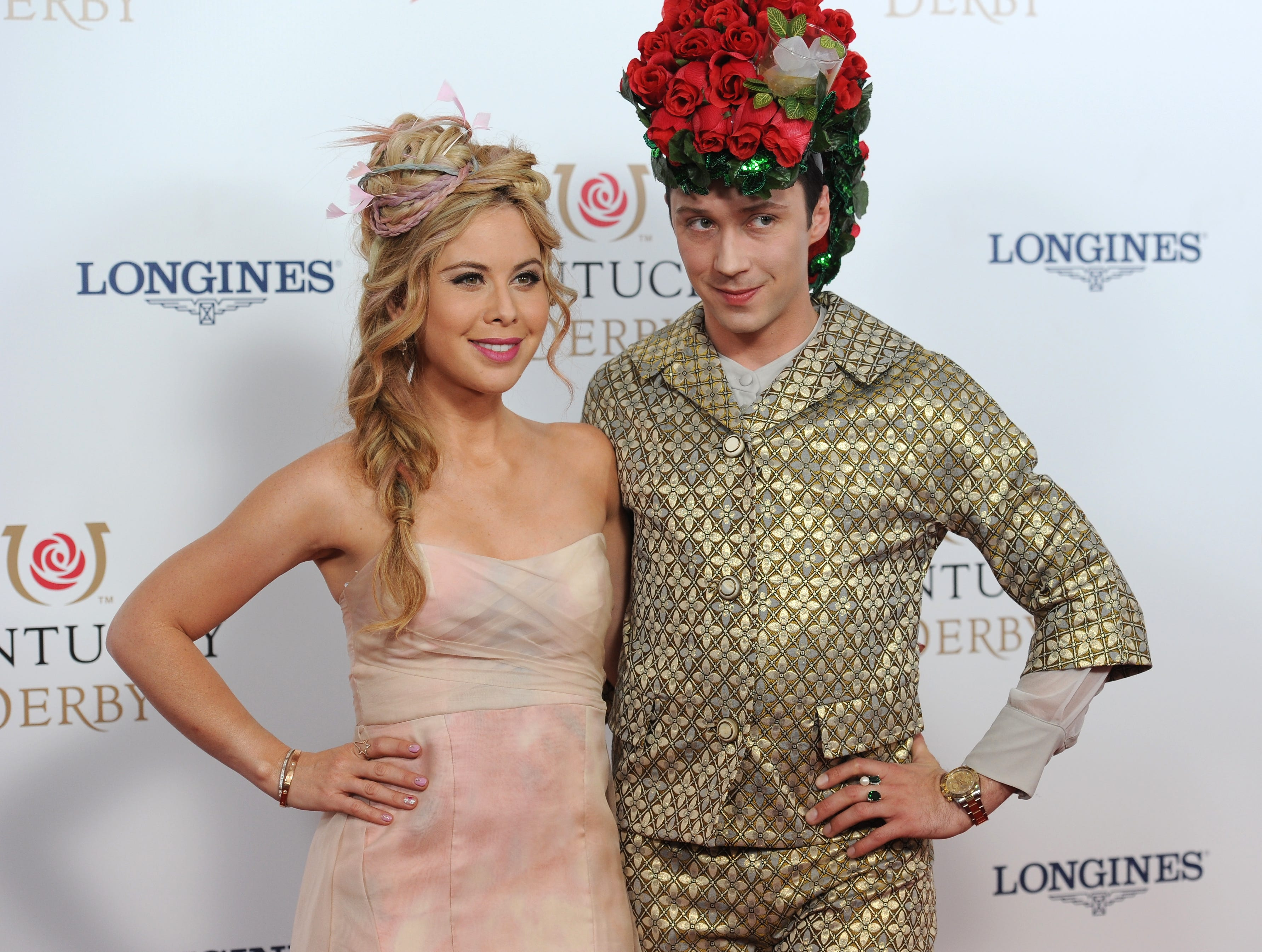 Tara Lipinski (left) and Johnny Wier arrive on the red carpet at the 2015 Kentucky Derby on Saturday, May 2, 2015 at Churchill Downs in Louisville, Ky.