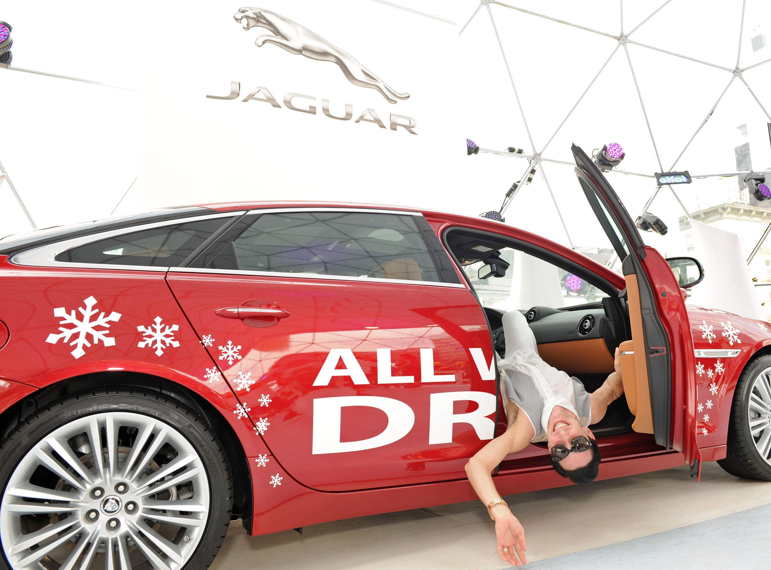 Two-time Olympian and world bronze medalist figure skater Johnny Weir poses in the 2013 Jaguar XJ AWD at the brand's Chill NY event on August 17, 2012 in New York City.