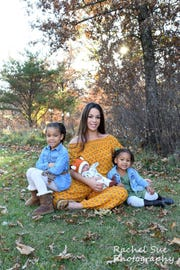 Katrina Jabbi with her daughters Nalia, 7, Aisha, 3, and son Noble, five months.