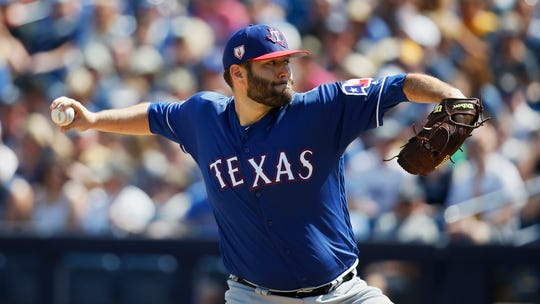 Texas Rangers' Lance Lynn pitches during a spring training baseball game against the Milwaukee Brewers Tuesday, March 19, 2019, in Phoenix (AP Photo/Sue Ogrocki)