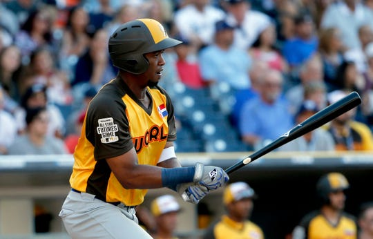 FILE - In this July 10, 2016, file photo, World Team's Eloy Jimenez hits against the U.S. Team during the seventh inning of the All-Star Futures baseball game in San Diego. A person familiar with the negotiations tells The Associated Press Wednesday, March 20, 2019, that the Chicago White Sox are nearing a $43 million, six-year contract with highly regarded outfield prospect Eloy Jimenez.  (AP Photo/Lenny Ignelzi, File)