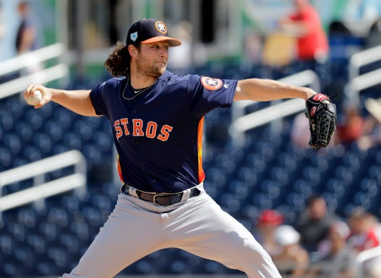Houston Astros starting pitcher Gerrit Cole throws during the first inning of an exhibition spring training baseball game against the Washington Nationals Sunday, March 3, 2019, in West Palm Beach, Fla. (AP Photo/Jeff Roberson)