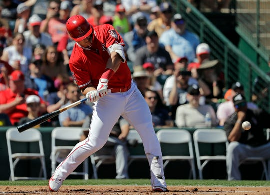 Los Angeles Angels' Mike Trout hits a three-run home run against the Chicago White Sox in the first inning of a spring training baseball game Friday, March 22, 2019, in Tempe, Ariz. (AP Photo/Elaine Thompson)