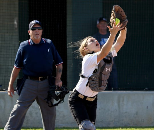 Archer City's Lindy Reid catches a popup against Petrolia Monday, March 25, 2019, in Archer City.