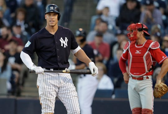 New York Yankees' Aaron Judge after an inside pitch from Philadelphia Phillies starting pitcher Jerad Eickhoff during the third inning of a spring training baseball game Friday, March 22, 2019, in Tampa, Fla. (AP Photo/Chris O'Meara)