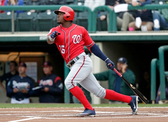 Washington Nationals' Victor Robles bats against the Atlanta Braves in a spring baseball exhibition game, Tuesday, March 19, 2019, in Kissimmee, Fla. (AP Photo/John Raoux)