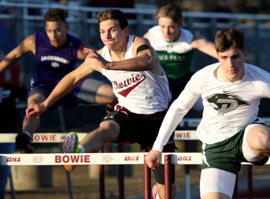Bowie's AJ Craddock competes in the 110 hurdles Monday, March 25, 2019, for Jackrabbit Relays in Bowie.
