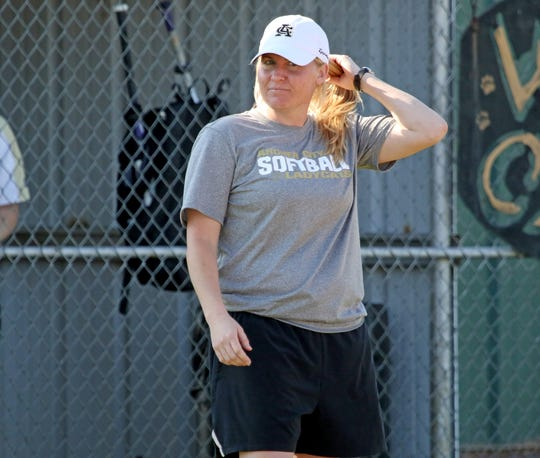 Archer City head softball coach Mallory Mooney watches the game against Petrolia Monday, March 25, 2019, in Archer City.