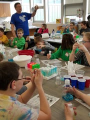 Tom Zinnen, Biotrek Outreach specialist at UW-Extension, helped students at SAGES learn more about the composition of milk through a series of test-tube experiments.