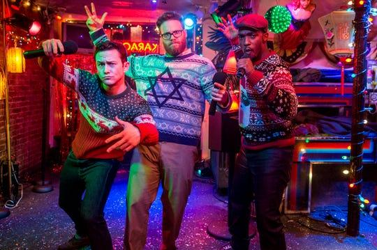 Joseph Gordon-Levitt (left), Seth Rogen and Anthony Mackie get their Christmas karaoke on in 'The Night Before.'