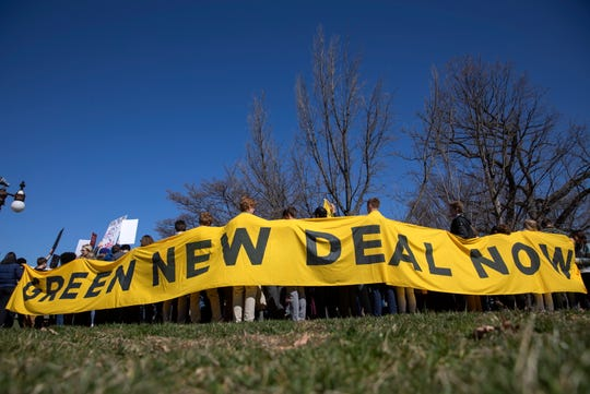 Banner at gathering of Green New Deal supporters outside the US Capitol in Washington on March 26, 2019.