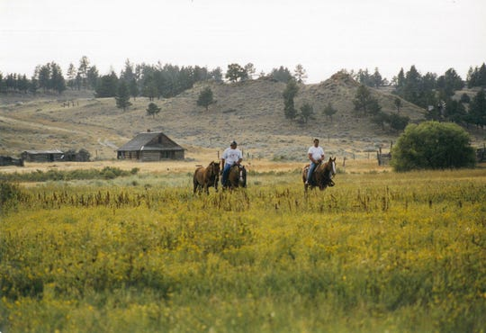 Bert Pezzarossi and husband Dan ride horses in the lush countryside of Montana.