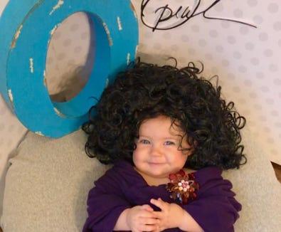 Liberty Wexler as Oprah Winfrey.