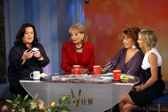 "Rosie O'Donnell, left, with her former ""View"" co-hosts Barbara Walters,  Joy Behar, and Elisabeth Hasselbeck during a taping of ABC's morning program in 2006."