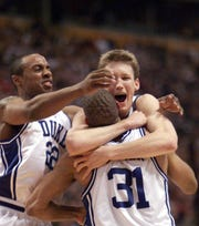 Jason Williams , left, Mike Dunleavy and Shane Battier celebrate the NCAA championship game in 2001.