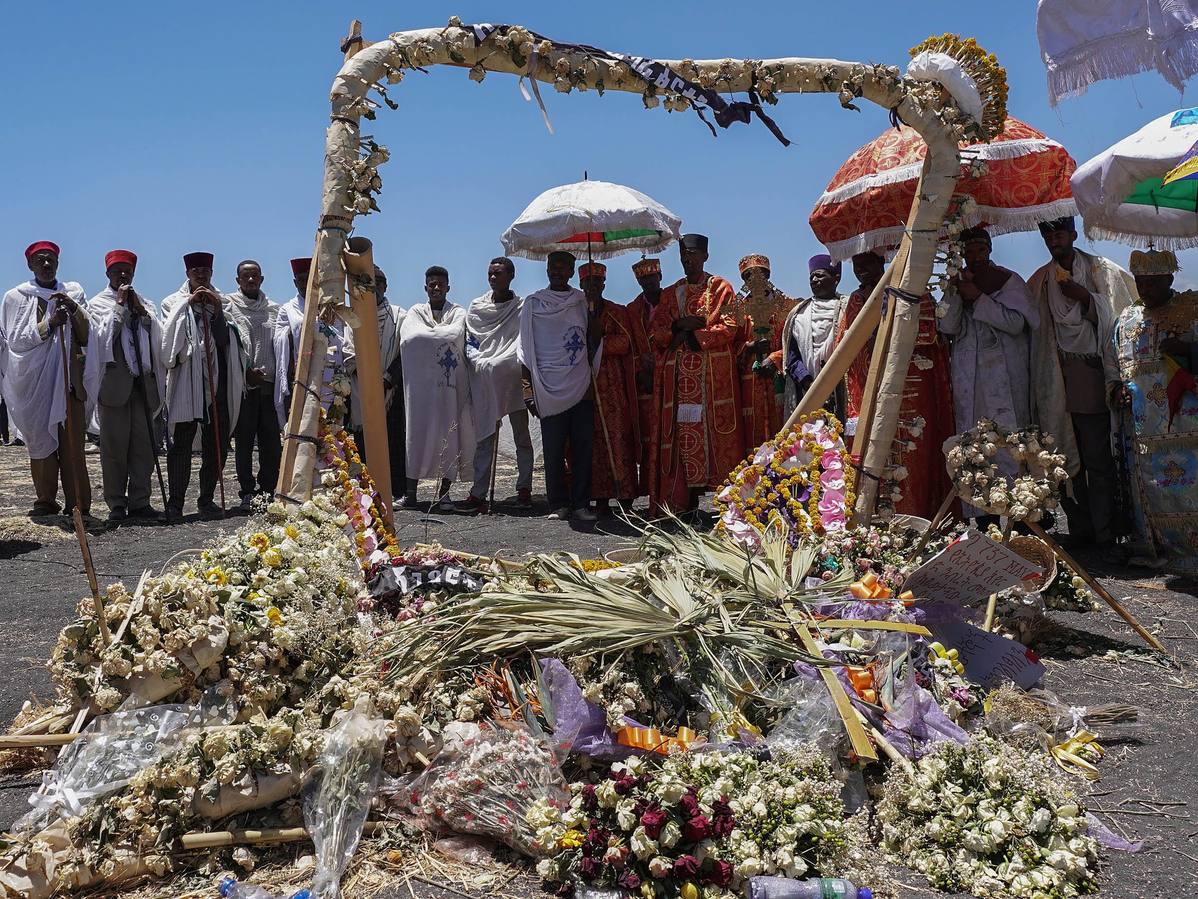 Priest from the Ethiopian Orthodox Church pray and sing during the Asrahhullet or Tulluferra ceremony on March 21, 2019 in Ejere, Ethiopia.