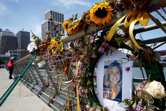 In this July 17, 2015 file photo, flowers and a portrait of Kate Steinle remain at a memorial site on Pier 14 in San Francisco. A federal appeals court on Monday, March 25, 2019 refused to reinstate a lawsuit her parents filed against San Francisco for refusing to cooperate with federal immigration authorities seeking to deport a man later charged with killing Steinle.