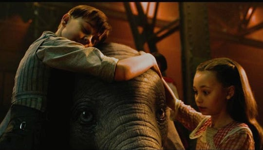 Joe (Finley Hobbins) and Milly (Nico Parker) encourage Dumbo to fly, in hopes of reuniting him with his mother.