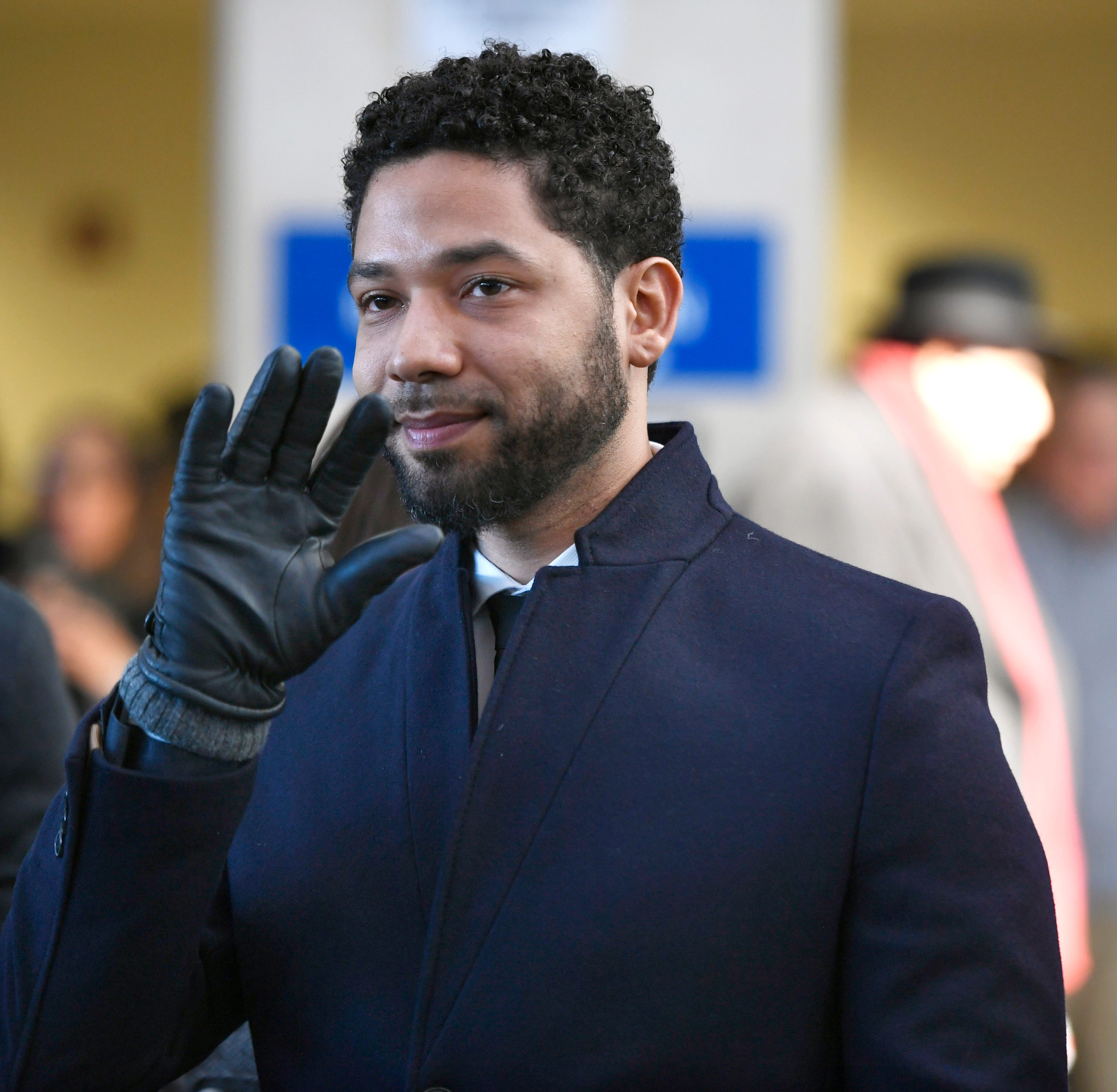 Actor Jussie Smollett smiles and waves to supporters before leaving Cook County Court after his charges were dropped Tuesday, March 26, 2019, in Chicago.