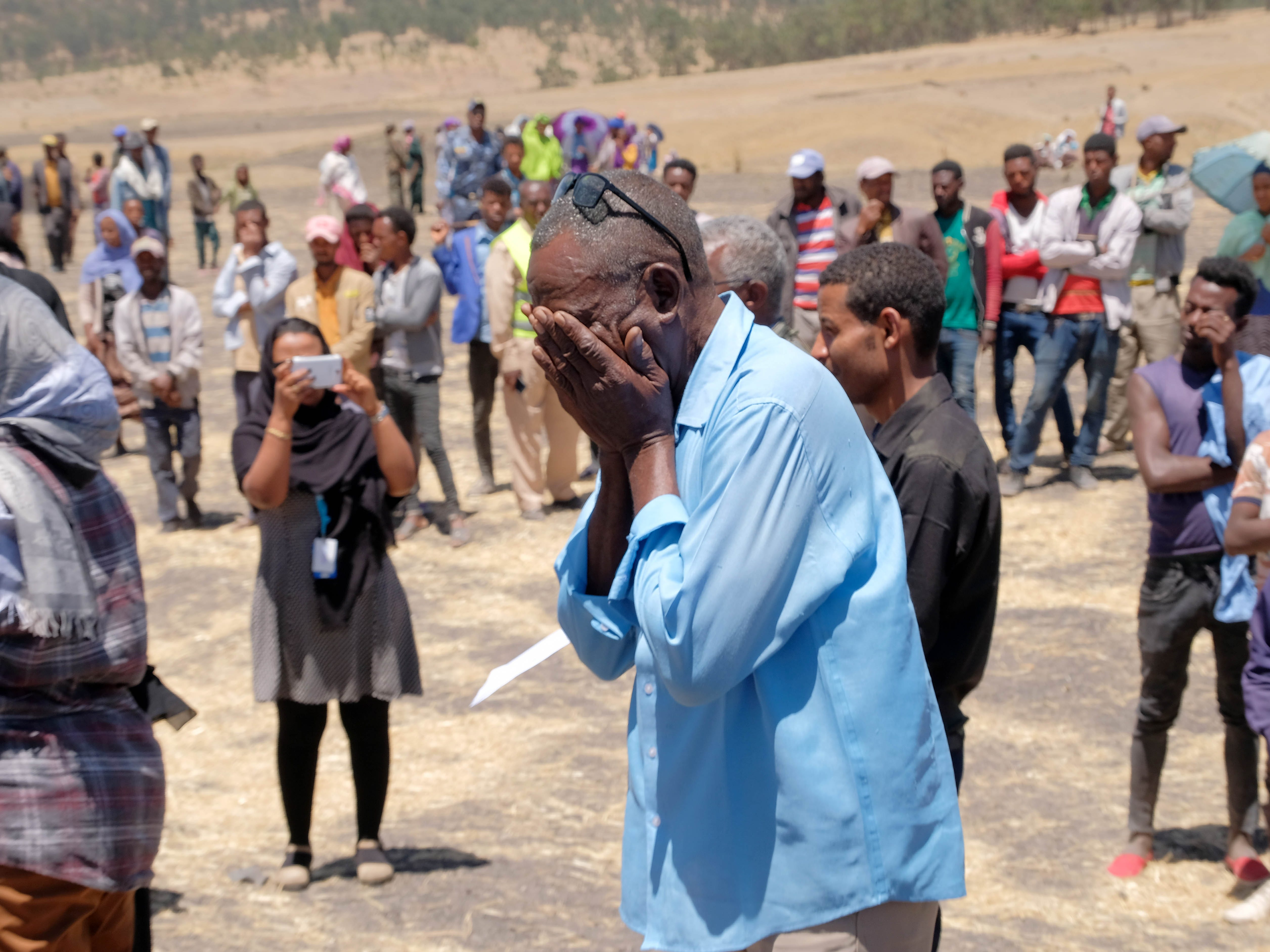 A man weeps for a loved one lost on Ethiopian Airlines Flight 302 during the Asrahhullet or Tulluferra ceremony on March 21, 2019 in Ejere, Ethiopia.