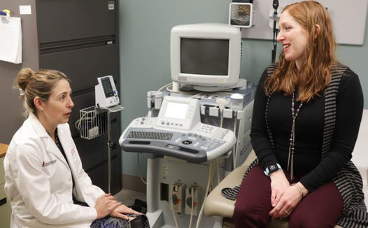 Dr. Kara Rood speaks with a pregnant woman during a prenatal visit at The Ohio State University Wexner Medical Center. Dr. Rood led a study to diagnose preeclampsia, a condition that can be fatal if not diagnosed and treated quickly.