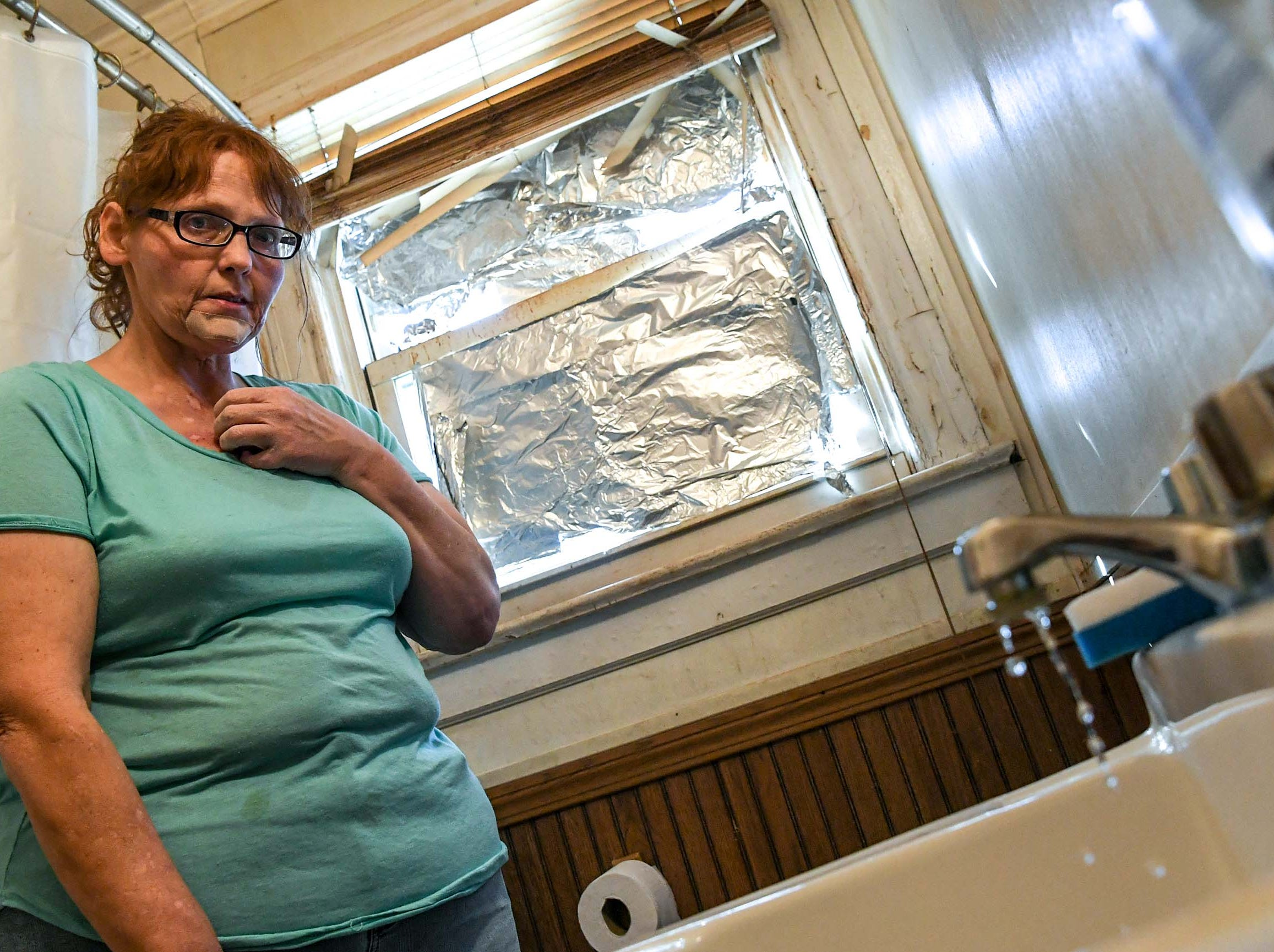 Kristy Drees of Anderson is unhappy with a leaky faucet and holes through the floor in her bathroom unprepared at the rental home in Homeland Park in Anderson in March. The problems with the water company and courtroom battles with her landlord while being unemployed she says is stressful.