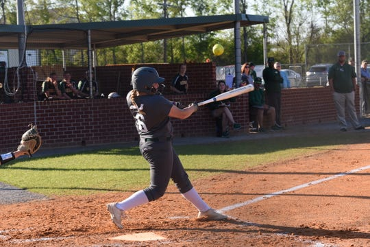 Rapides senior pitcher Sydney Lewis hits a pop fly against Menard Tuesday, March 26, 2019. Menard won 3-1.