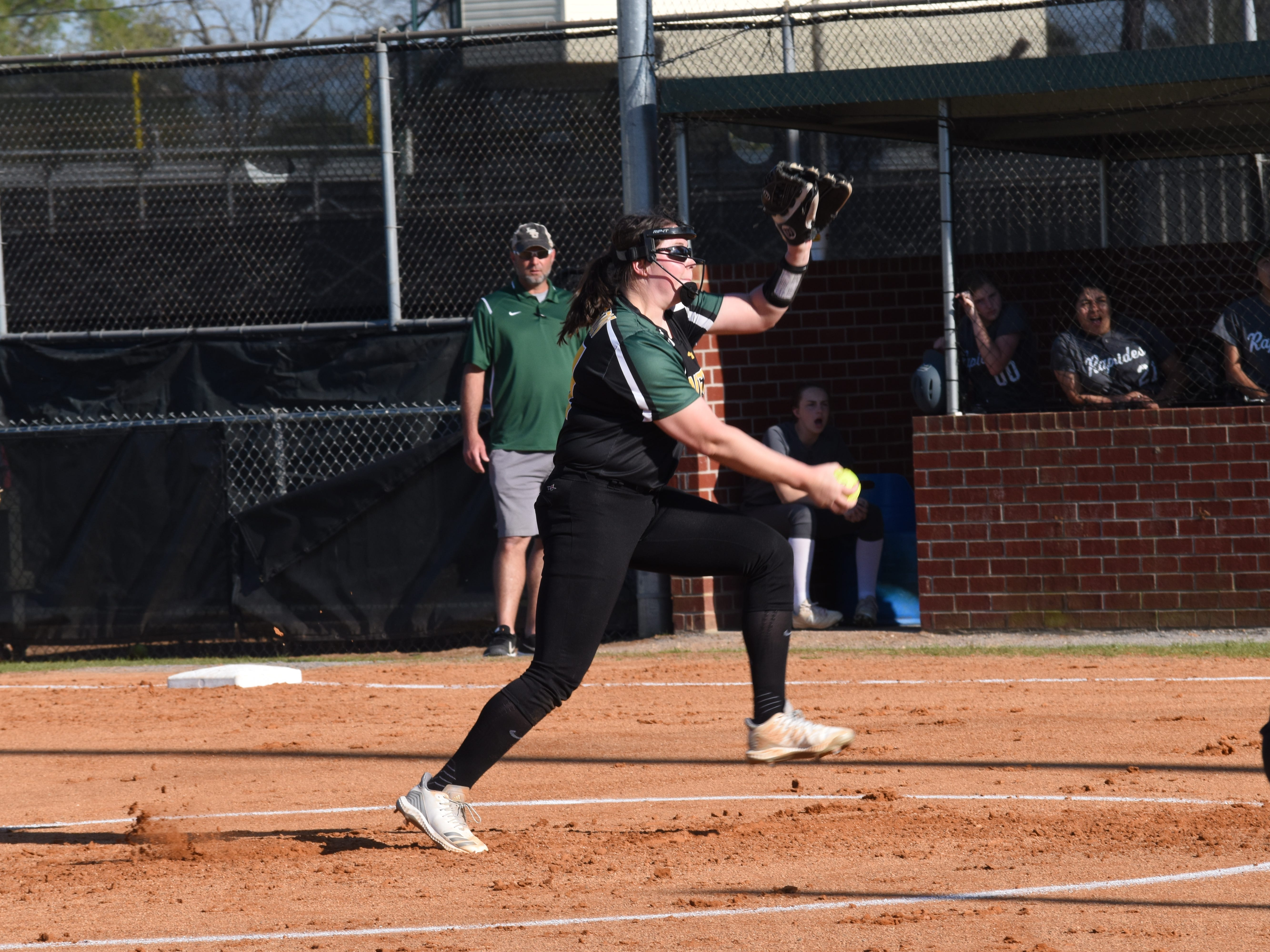 Holy Savior Menard's Olivia Johnson hurls a pitch against Rapides High School Tuesday, March 26, 2019. Menard won 3-1.