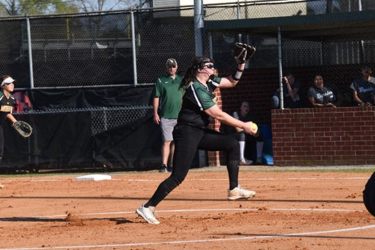 Holy Savior Menard's Olivia Johnson hurls a pitch against Rapides High School Tuesday, March 26, 2019. Johnson was one of three Menard players on the LSWA Class 2A softball team.