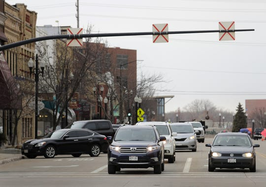 Traffic moves east on Wisconsin Avenue through downtown Neenah.