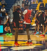 Scottie Lewis (left) and Bryan Antoine converse Tuesday during a scrimmage as part of McDonald's All-American Game fetivities