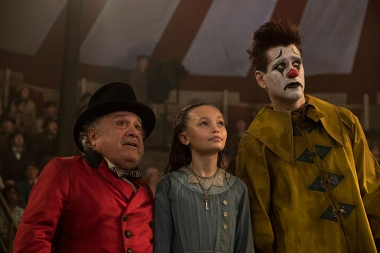 """Danny DeVito, from left, Nico Parker and Colin Farrell in Disney's """"Dumbo,"""" directed by Tim Burton."""